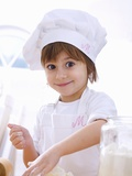 Little Girl Mixing Pastry Ingredients Photographic Print