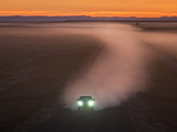 Car on Gravel Road in Badlands, South Dakota, USA Photographic Print by Christian Heeb