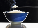 A Bowl of Steaming Rice Photographic Print by Peter Rees
