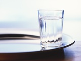 A Glass of Water on a Tray Photographic Print by Karlheinz Wilker