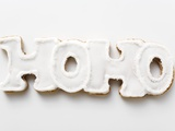 The Word Hoho in Gingerbread with White Icing Photographic Print