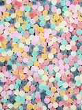 Lots of Brightly Colored Chewy Candies Photographic Print by Neil Overy