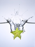 Slice of Carambola Falling into Water Photographic Print by  Kröger & Gross