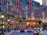 UK, England, London, Regent Street, Taxis and Union Jack Flags Photographic Print by Alan Copson