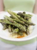 Woman Holding a Plate of Grilled Green Asparagus Photographic Print