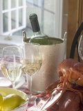 White Wine Bottle in Ice Bucket, Wine Glasses, Lobster, Lemon Photographic Print