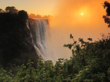Victoria Falls at Sunrise, Zambezi River, Near Victoria Falls, Zimbabwe, Africa Photographic Print by Christian Heeb