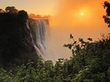 Victoria Falls at Sunrise, Zambezi River, Near Victoria Falls, Zimbabwe, Africa Photographic Print by Christian Heeb