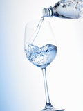 Pouring Water into a Glass Photographic Print by Klaus Arras