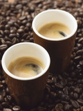 Two Espressos Standing on Coffee Beans Photographic Print