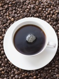 Cup of Black Coffee on Coffee Beans Photographic Print