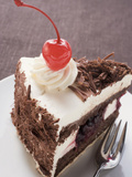 Piece of Black Forest Gateau with Cherry Photographic Print