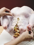 Closing Up Stuffed Turkey with Kitchen String Photographic Print