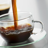 Pouring Coffee into a Glass Cup Photographic Print by Alexander Feig