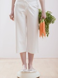 Young Woman with Carrots on Bathroom Scales Photographic Print