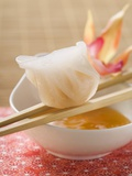 Dim Sum on Chopsticks over Dip (Asia) Photographic Print
