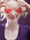 Young Woman Holding Hearts in Front of Her Eyes Photographic Print