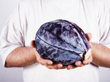 Man Holding a Red Cabbage in Both Hands Photographic Print by Elisabeth Cölfen