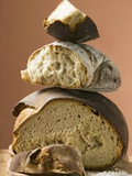 Rustic Bread, Two Loaves with Pieces Cut Off in a Pile Photographie