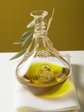 Olive Oil in Carafe with Olive Branch Photographic Print