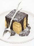 Baumkuchen (German Layer Cake) with Chocolate Sauce and Sugar Photographic Print by  Rogge & Jankovic