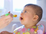 Baby Being Fed Baby Food Photographic Print