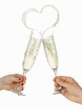 Clinking Glasses of Sparkling Wine (With Heart-Shaped Splash) Photographic Print by  Kröger & Gross