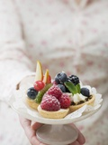Woman Holding Berry Tarts on Cake Stand Photographic Print