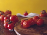 Fresh and Skinned Tomatoes Photographic Print by Paolo Nobile