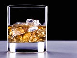 A Glass of Whisky with Ice Cubes Photographic Print by Mark Vogel
