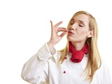 Blond Female Chef Blowing a Kiss Photographic Print by Robert Kneschke