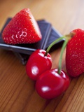 Pieces of Chocolate with Cherries and Strawberries Photographic Print by Malgorzata Stepien