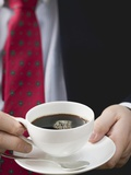 Man Holding Cup of Coffee Photographic Print
