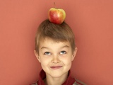 Small Boy with Apple on His Head Fotografisk tryk af Marc O. Finley