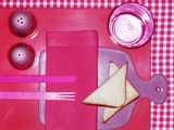 A Pink Place Setting with Toast Triangles Photographic Print by Heidi Frohlich