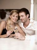 Young Couple Clinking Glasses of White Wine Photographic Print by  Sporrer & Skowronek