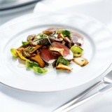Venison Fillet with Sprout Leaves and Chanterelle Mushrooms Photographic Print by Stefan Braun