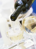 White Wine Pouring from Bottle into Glass; White Background Photographic Print by Linda Burgess
