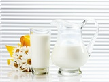 Milk in Glass and Glass Jug Photographic Print by Dieter Heinemann
