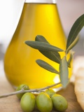 Olive Oil and Olive Sprig with Green Olives Photographic Print