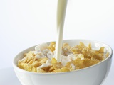 Pouring Milk over Cornflakes Photographic Print by Marc O. Finley