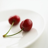 Two Cherries on a Plate Photographic Print by Dave King