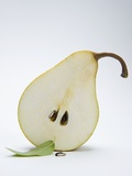 Half a Pear with a Leaf Photographic Print by Susanne Casper-zielonka