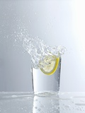 Water Splashing Out of a Glass Photographic Print by Karl Newedel