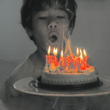 A Boy with a Birthday Cake Photographic Print