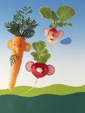 Amusing Carrot and Radish Figures Fotografie-Druck von Ulrich Kerth