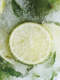 Limes in Block of Ice Photographic Print by Dieter Heinemann