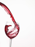 Red Wine Pouring into a Glass from Bottle Photographic Print