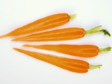 Four Slices of Carrot with Tops Photographic Print by Harry Bischof