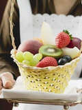 Waitress Serving a Basket of Fruit Photographic Print